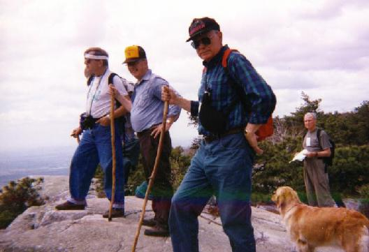 A group of INTMON hikers standing along the Shawangunk Ridge in the early Spring of 1995.